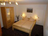 schlafzimmer_2_im_guesthouse-elbsandstein_appartement_lilienstein_20110121_1985882359